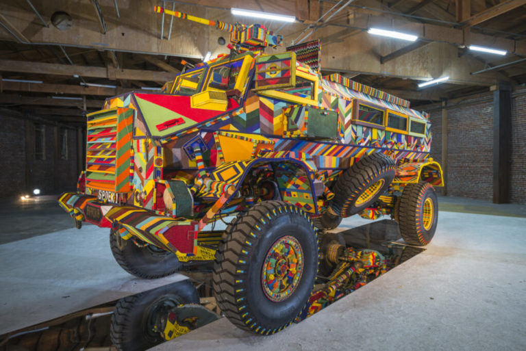 South African police transport turned into tribal art for Fort Mason show