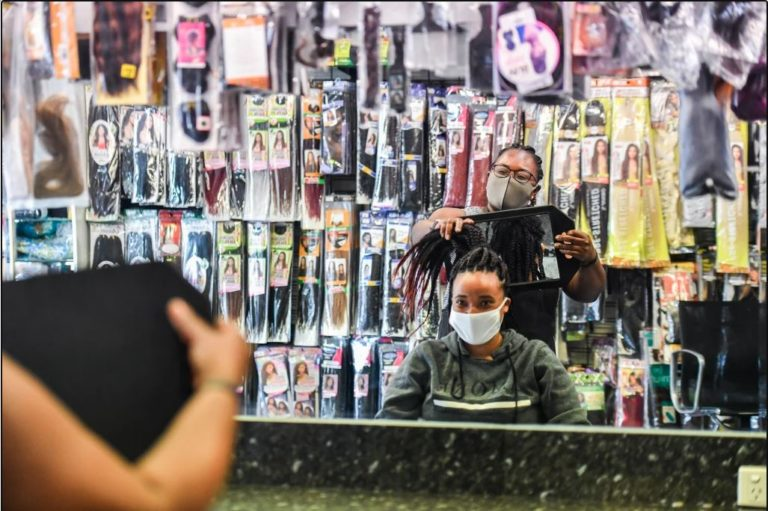 Chop, trim and a chat: hairdressers keep migrant communities woven together